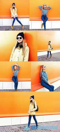 Fashion Pretty Blonde Girl Posing Over Colorful Orange Background